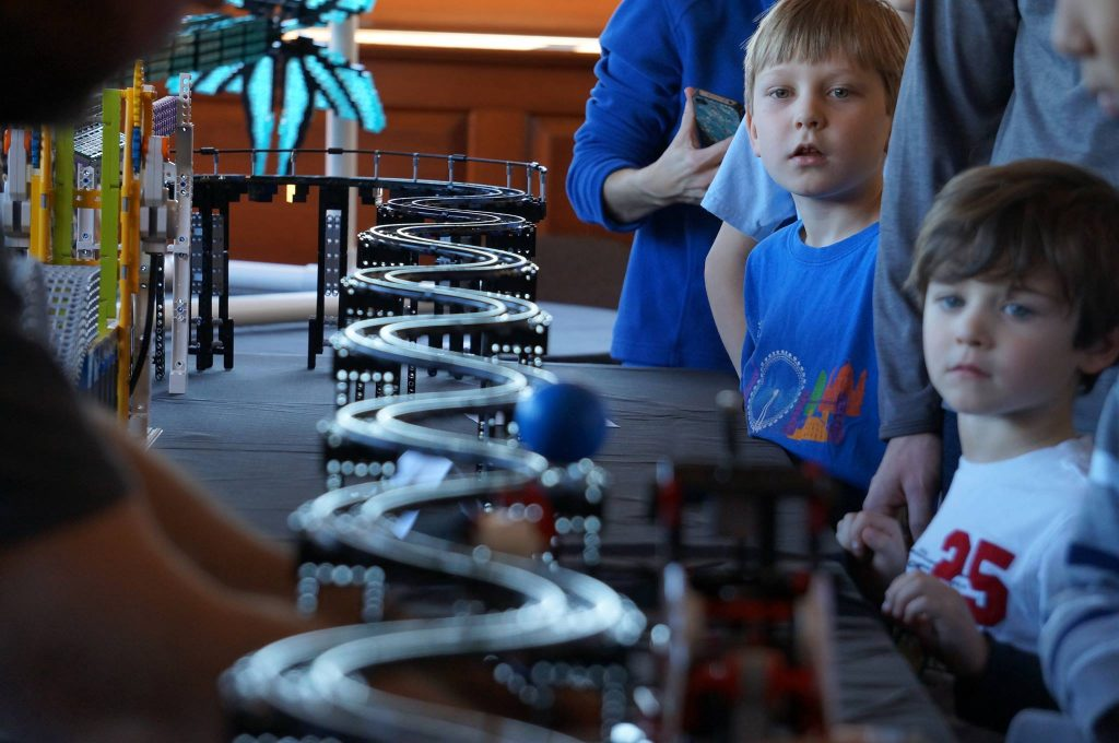 Close up of boys viewing LEGO exhibition at Morehead during LEGO-palooza 2015