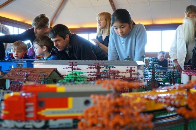 Families looking at lego creations