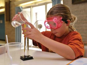 A young girl participates in a GSK Science in the Summer program.