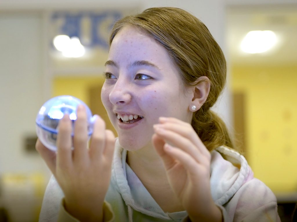 Student holding a sphero
