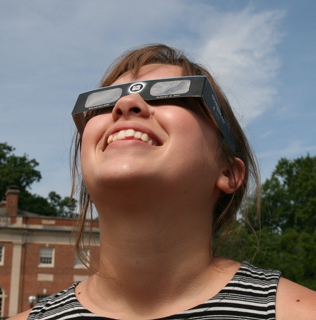 Woman wearing solar eclipse glasses
