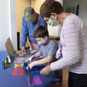 museum goers explore exhibit
