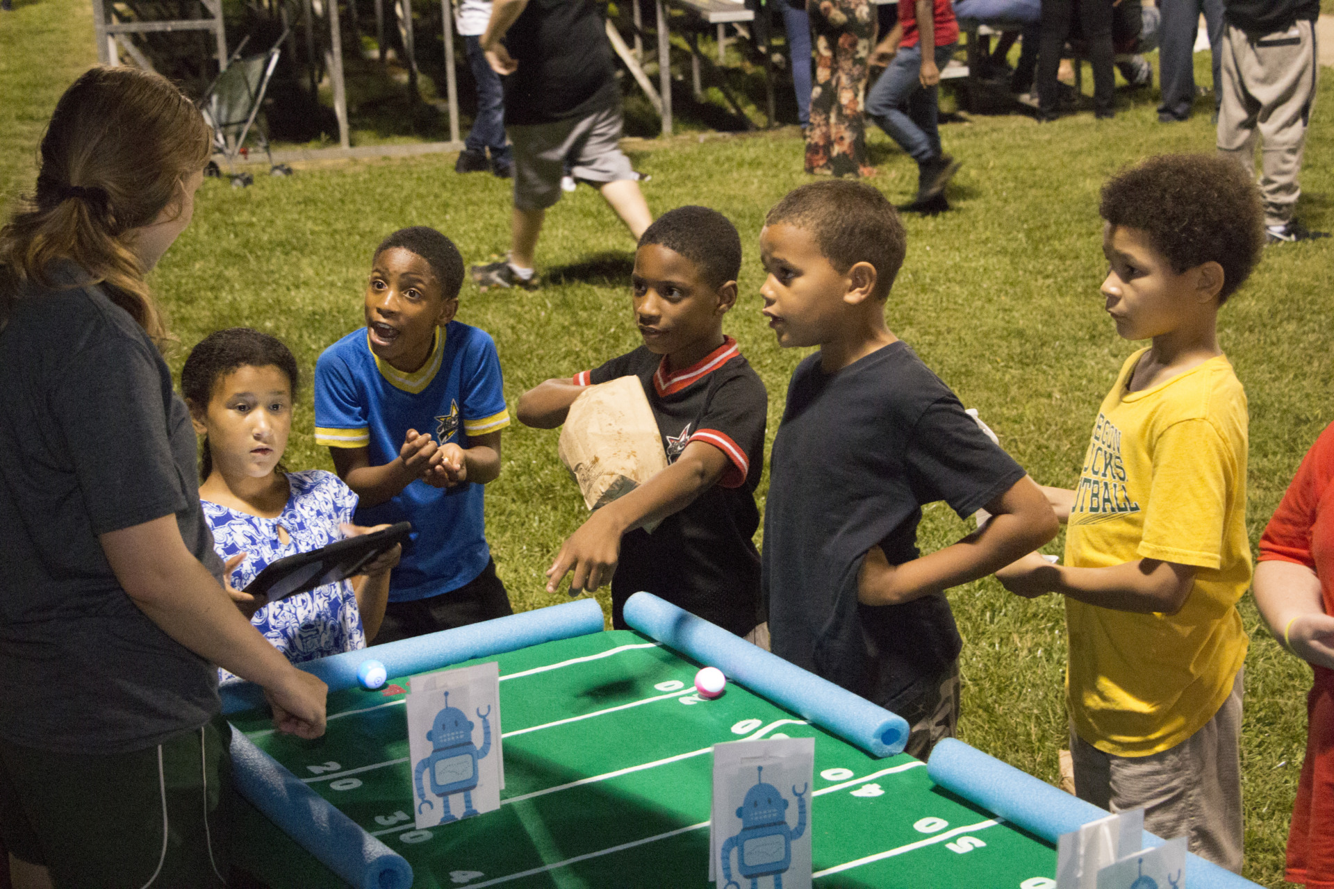 children playing table football game at tailgate