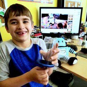 Child with Kelvin at virtual NCSF programming