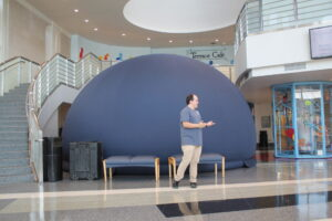 Mobile planetarium dome and educator