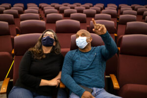 two people in theater